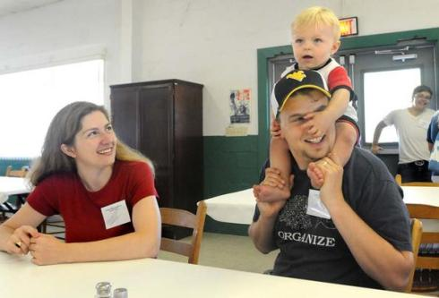 John Wessel McCoy holds his 1-year-old son, Myles, on his shoulder as his wife Colleen looks on during the first day of a leadership conference Sunday at Camp Virgil Tate.